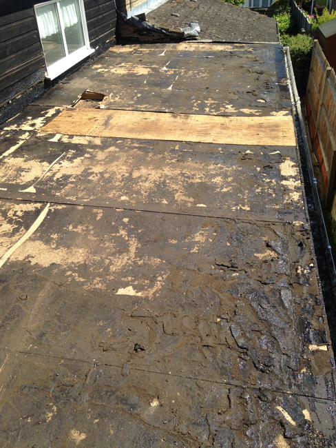 1. Existing felt stripped and decking in need of replacement